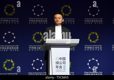 Dunhuang, China's Gansu Province. 23rd Apr, 2019. Jack Ma, chairman of China's e-commerce giant Alibaba, gives a keynote speech during the China Green Companies Summit 2019 in Dunhuang, northwest China's Gansu Province, on April 23, 2019. The summit was held from April 22 to 23 in Dunhuang. Credit: Fan Peishen/Xinhua/Alamy Live News - Stock Image