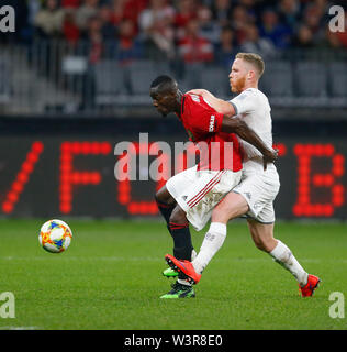 Optus Stadium, Burswood, Perth, W Australia. 17th July 2019. Manchester United versus Leeds United; pre-season tour; Eric Bailly of Manchester United holds off Adam Foresaw of Leeds United in Manchester United's half Credit: Action Plus Sports Images/Alamy Live News - Stock Image