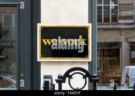 Sign on premises of WeWork shared office space in Hatton Garden, London. - Stock Image