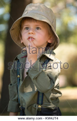 Little boy looking up - Stock Image