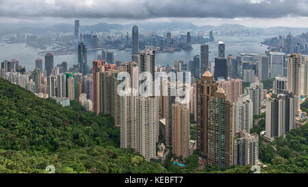 A panorama of the Hong Kong skyline from the Peak on a cloudy and stormy day - Stock Image