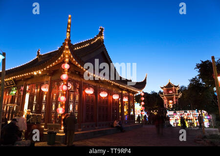 The Friendship Hall pavilion and the Magic of Lanterns exhibit at dusk in the Chinese Garden, Montreal Botanical Garden, Quebec, Canada - Stock Image