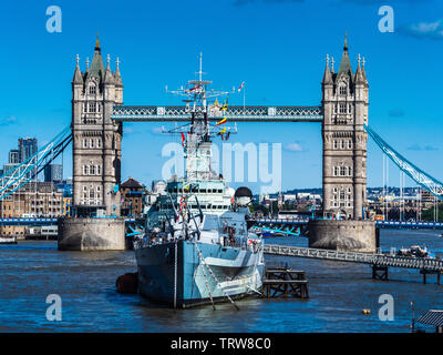HMS Belfast in front of Tower Bridge - London Tourism - Stock Image