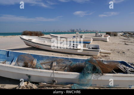 View of Manama with fishing boats in the foreground, Nurana Island, Kingdom of Bahrain - Stock Image
