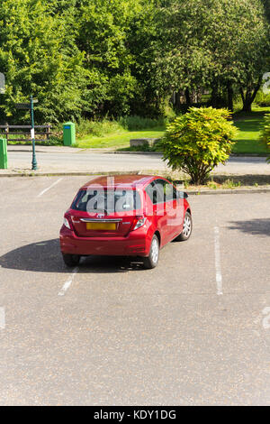 A Toyota Yaris carelessly parked across a marked parking bay at Burrs Country Park, Bury. - Stock Image