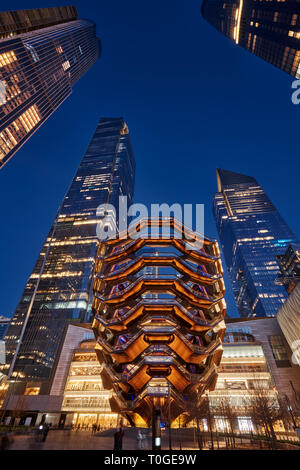 The Vessel, also known as the Hudson Yards Staircase (designed by architect Thomas Heatherwick) at dusk. Manhattan, New York City - Stock Image