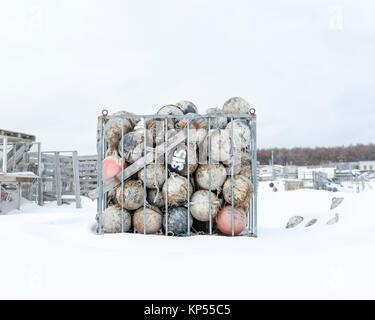Plastic fishing floats stored for the winter in Hokkaido Japan - Stock Image