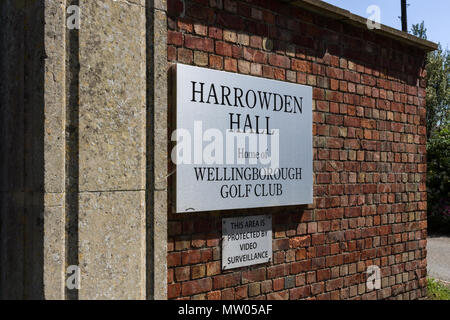 wall mounted sign for Harrowden Hall, an 18th century historic house, now the home to Wellingborough Golf Club, Northamptonshire, UK - Stock Image