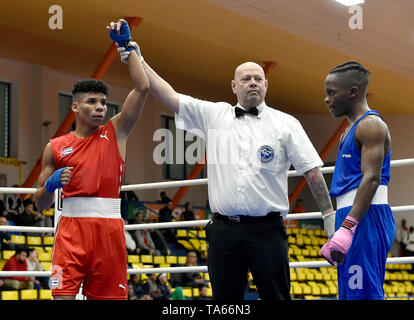 Usti Nad Labem, Czech Republic. 22nd May, 2019. From left YOSBANY VEITIA SOTO of Cuba (winner) and PHILLIP MATOMBO of Canada after the fight in 50th boxing tournament Grand Prix Usti nad Labem, Czech Republic, May 22, 2019. Credit: Ondrej Hajek/CTK Photo/Alamy Live News - Stock Image