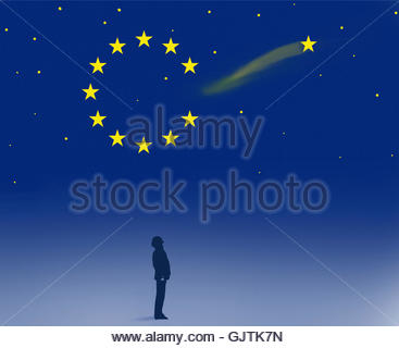 Man watching shooting star leaving European Union flag symbol - Stock Image