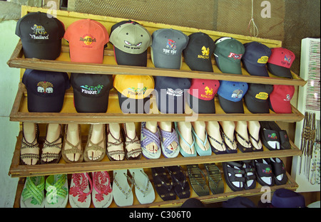 Variety of caps and shoes - Stock Image