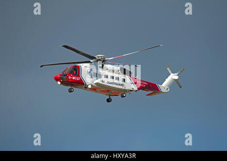 Inverness based Sikorsky S-92A Coastguard SAR helicopter departing from its home base on a mission. - Stock Image