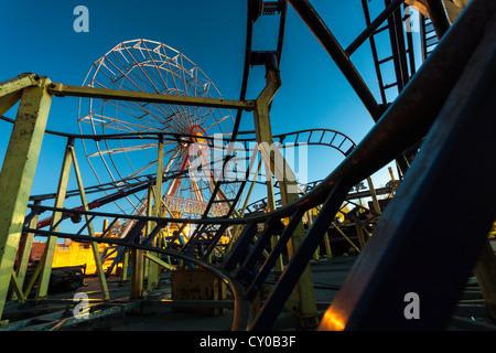 Roller coaster at night. - Stock Image