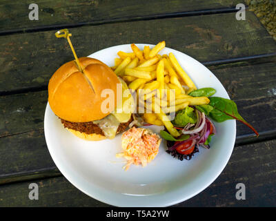 Lord Stones Café  lunch  a Sloppy Joe prime Belted Galloway  beef burger  with melted cheddar cheese served with coleslaw chips and salad - Stock Image
