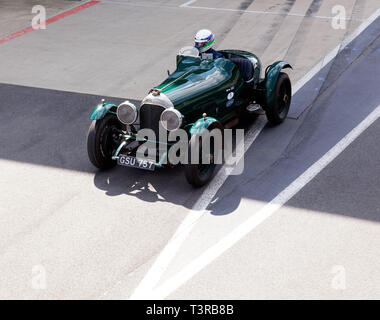 Looking down on a Green, 1928 Bentley 3/4.5litre Sports car  exiting the Pit lane at the2019  Silverstone Classic Media/Test Day. - Stock Image