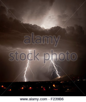 A huge lightning bolt strikes the side of the Santa Catalina Mountains near Pusch Ridge at night summer monsoon - Stock Image