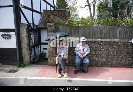 Bolney Sussex, UK. 22nd Apr, 2019. Spetcators stay cool in the shade at the annual Bolney Pram Race in hot sunny weather . The annual races start and finish at the Eight Bells Pub in the village every Easter Bank Holiday Monday Credit: Simon Dack/Alamy Live News - Stock Image