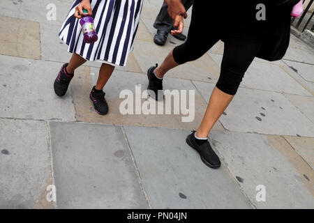 Mother and daughter walking to school on a street in London UK  KATHY DEWITT - Stock Image