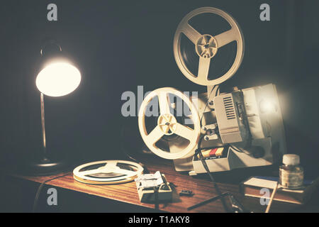 retro 8mm movie projector on the table - Stock Image