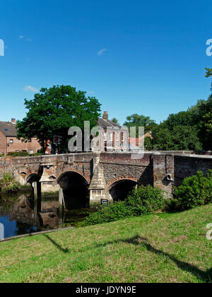 The Ancient, 14th Century, Bishop Bridge, spanning The River Wensum in Norwich, Norfolk, England, UK - Stock Image