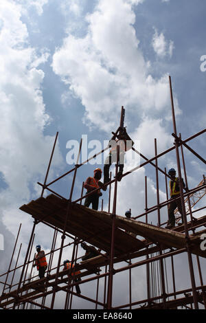 Workers on a scaffolding at a construction site in Lagos Nigeria - Stock Image