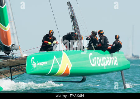 Portsmouth, UK. 25th July 2015. Groupama Team France crew in action as they approach a windward mark during race - Stock Image