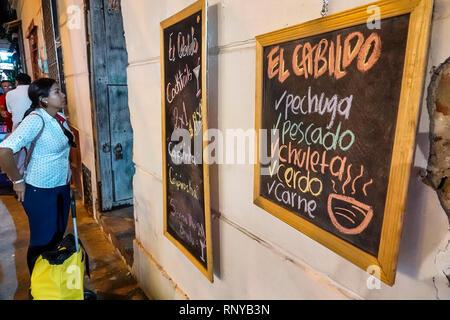 Cartagena Colombia Old Walled City Center centre Getsemani night nightlife Hispanic resident residents El Cabildo restaurant exterior chalkboard menu - Stock Image