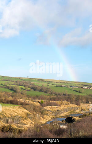 A rainbow above Harehope Quarry nature reserve near Frosterley, on the Weardale Way walk, Co. Durham, England, UK - Stock Image