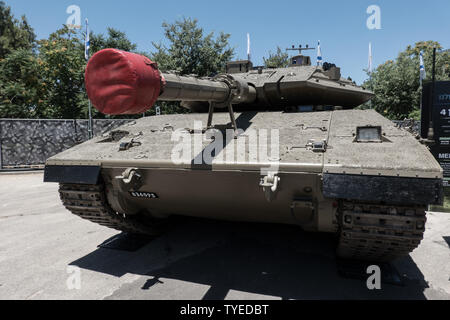 Jerusalem, Israel. 26th June, 2019. A Merkava Mark 4 tank stands on display. Operational in the IDF since 2004 it is equipped with the Trophy Advanced Active Protection System, weighs 60-80 tons and is capable of a speed of 64Kph. 'Our IDF' exhibition opens at the First Station in Jerusalem featuring armored combat vehicles, an F16 fighter jet, an audio video presentation and combat simulators based on virtual reality. The conscription based IDF, considered in Israel the 'people's army', opens its doors to the public free of charge fulfilling its role in creating a close bond with the public. - Stock Image