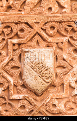 Detail of decorative plasterwork shield on the wall of the Alhambrs Palace in Granada Spain - Stock Image