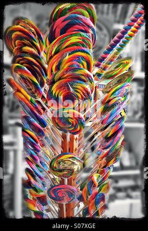 Stand full of colourful rainbow suckers - Stock Image
