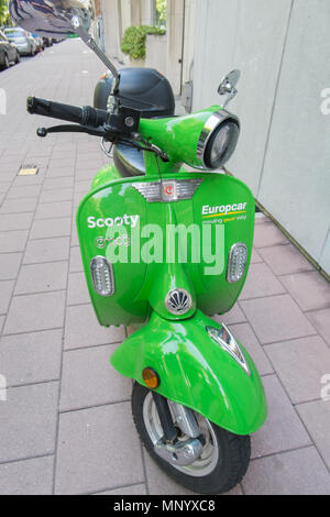 Green sharing scooter from scooty in antwerp, belgium - Stock Image