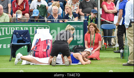 Eastbourne UK 24th June 2019 -  Danielle Collins of USA  receives medical attention during her match against Yulia Putintseva of Kazakhstan at the Nature Valley International tennis tournament held at Devonshire Park in Eastbourne . Credit : Simon Dack / TPI / Alamy Live News - Stock Image