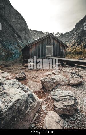 Boat dock hangar on Obersee mountain lake in Alps. Bavaria, Germany - Stock Image