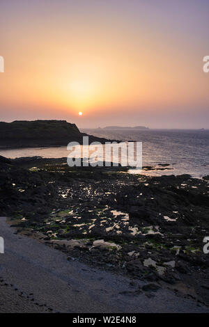 Sunset over small island at St Malo, Brittany, France - Stock Image
