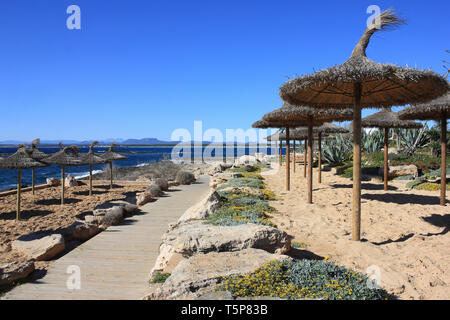 Wooden walkway along the promenade at Colonia Sant Jordi, Mallorca, Spain - Stock Image