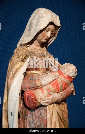 Detail of medieval Limestone and polychrome figure of Virgin Mary holding child Rolin Museum Autun Burgundy France - Stock Image