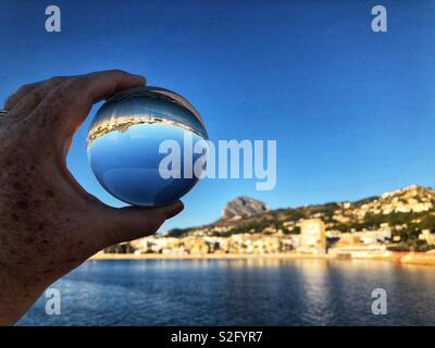 Early morning view through a crystal ball to marina and port, Javea, Xabia, Costa Blanca , Spain - Stock Image