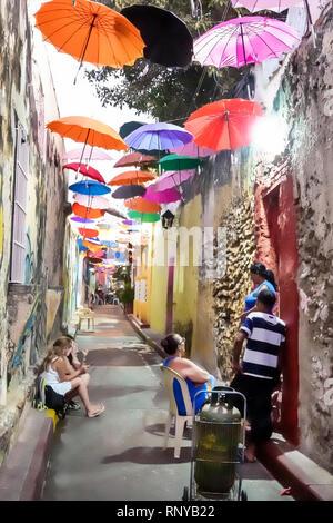 Cartagena Colombia Old Walled City Center centre Getsemani neighborhood Callejon Angosto Calle 27 narrow street hanging colorful umbrellas installatio - Stock Image