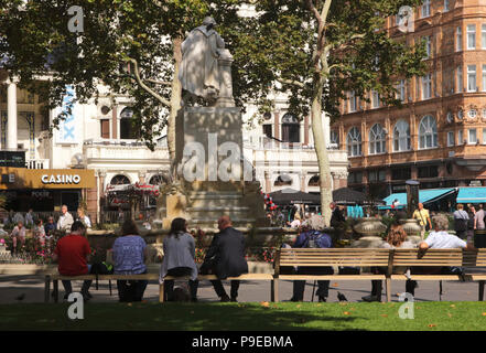 People relaxing near the William Shakespeare Statue Leicester Square London September 2017 - Stock Image