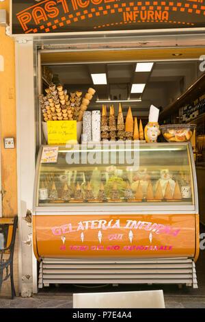 Italy Sicily Agrigento Gelateria Infurna Qui Il Vero Gelato Artigianae ice cream parlour parlor cone cones tubs freezer shop store wine - Stock Image