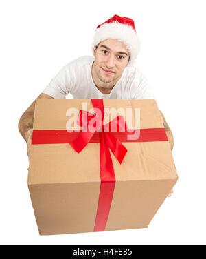Santa man looking up, holding gift - Stock Image