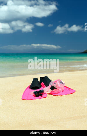 Snorkel, mask, and fins on tropical beach at Makena, Maui, Hawaii. - Stock Image