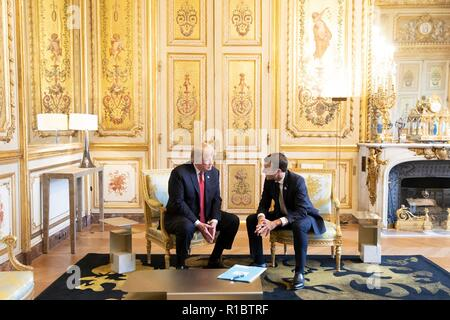 U.S President Donald Trump, left, during a bilateral meeting with French President Emmanuel Macron at the Elysee Palace November 10, 2018 in Paris, France. Trump is in France for commemorations marking the Centennial of the end of World War I. - Stock Image