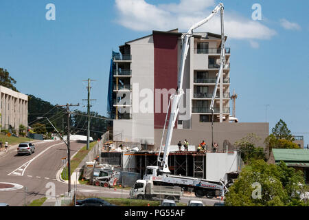 Gosford, New South Wales, Australia - November 2. 2017: Construction and building progress update 28.  Pumping concrete on new home units site, at 47  - Stock Image