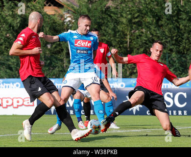 Stadium Carciato, Dimaro, Italy. 13th July, 2019. Pre-season football freindly, Napoli versus Benevento; Marko Rog of Napoli tackled by Gaetano Letizia of Benevento Credit: Action Plus Sports/Alamy Live News - Stock Image