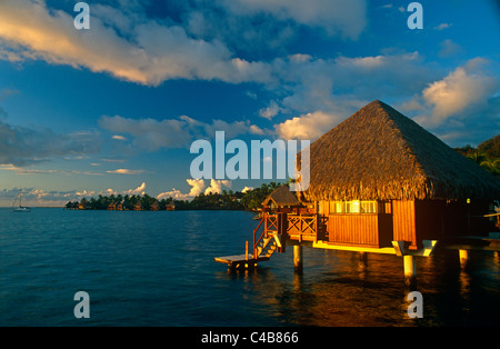 French Polynesia, Society Islands, Leeward Islands, Tahiti, Pape'ete. An over-water cottage at the Intercontinental - Stock Image