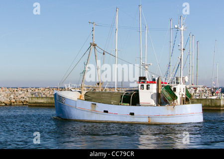 Fishing Boat, leaving the harbour, Gilleleje, Sjaelland, Denmark - Stock Image
