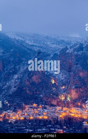 France, Alpes de Haute Provence, regional natural reserve of Verdon, Moustiers Sainte Marie, certified the Most beautiful Villages of France, overview of the village after a snowfall - Stock Image