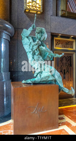 Bronze sculpture by Salvador Dali in the lobby of the Parkview Square. Singapore - Stock Image